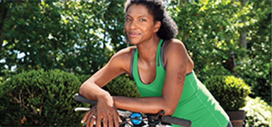 woman leaning on bicycle with eczema on arm 2